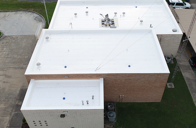 Right-side aerial view of Government Sector roofing, Police Dept. Professional finished roofing